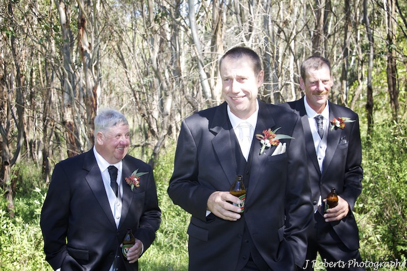 Groom and groomsmen having a beer - wedding photography sydney