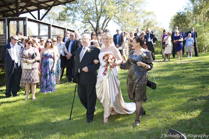 Bride and parents walking down the aisle - wedding photography sydney