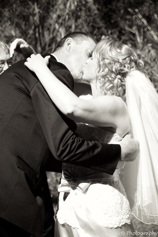 B&W bride and grooms first kiss - wedding photography sydney