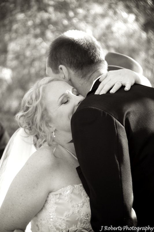 Bride and groom hugging - wedding photography sydney
