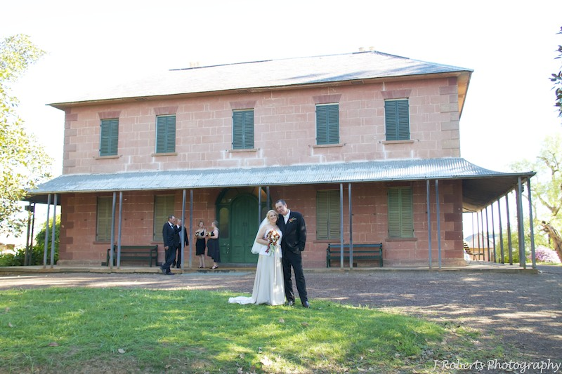 Bride and groom outside Rouse Hill House - wedding photography sydney