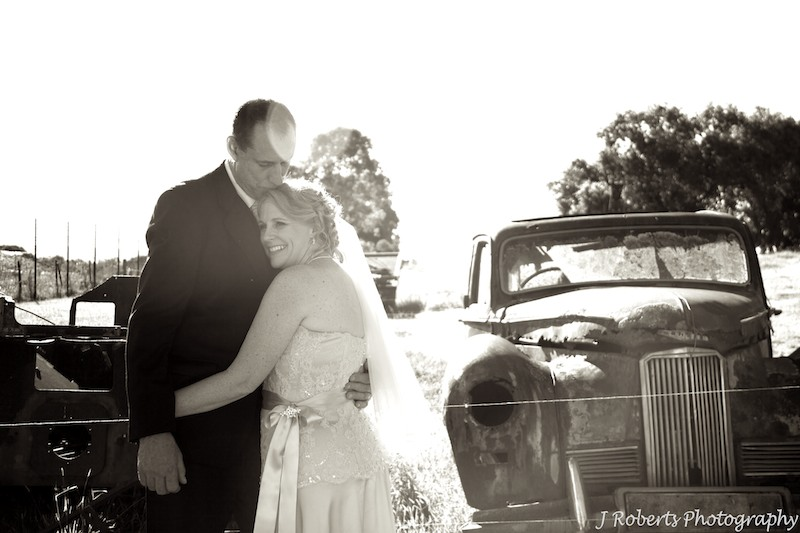 Sepia bride and groom on farm - wedding photography sydney