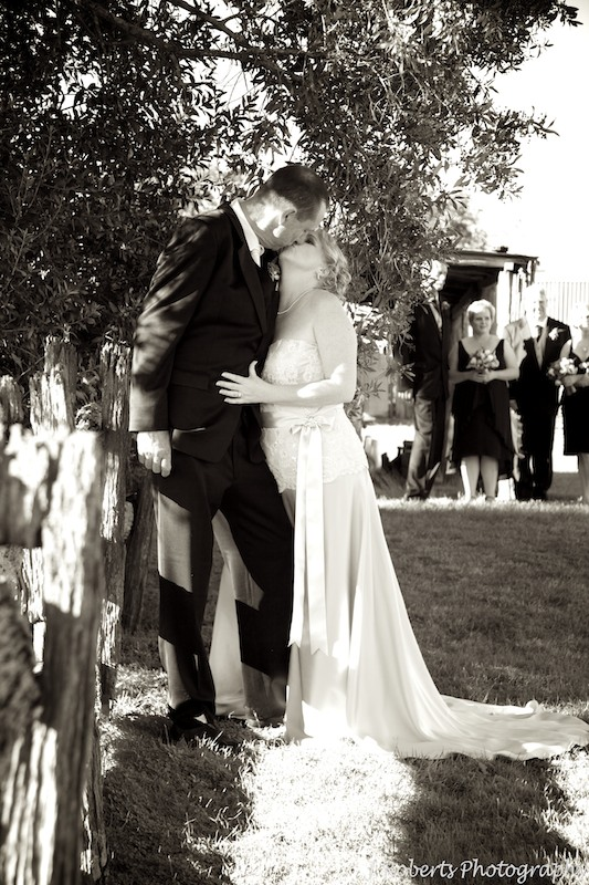 Sepia photo bride and groom kissing - wedding photography sydney