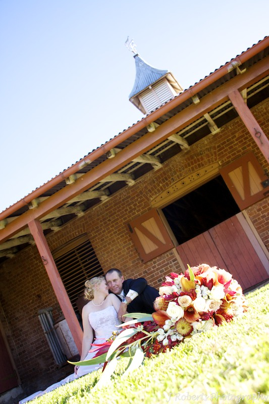 Bride and groom in front of stables - wedding photography sydney