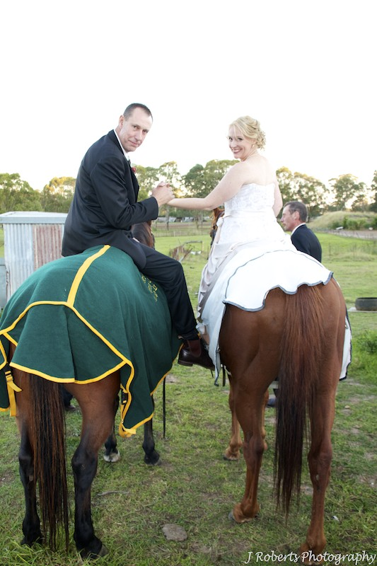 Bride and groom on horseback - wedding photography sydney
