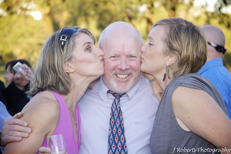 Girls kissing a bloke - wedding photography sydney