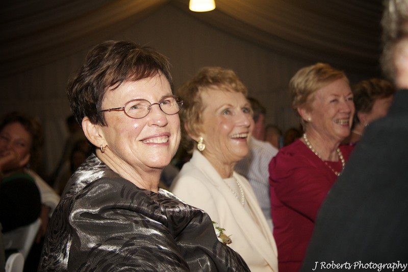 Guests laughing at speeches - wedding photography sydney
