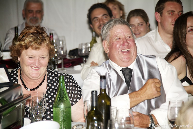 Guests laughing during speeches - wedding photography sydney