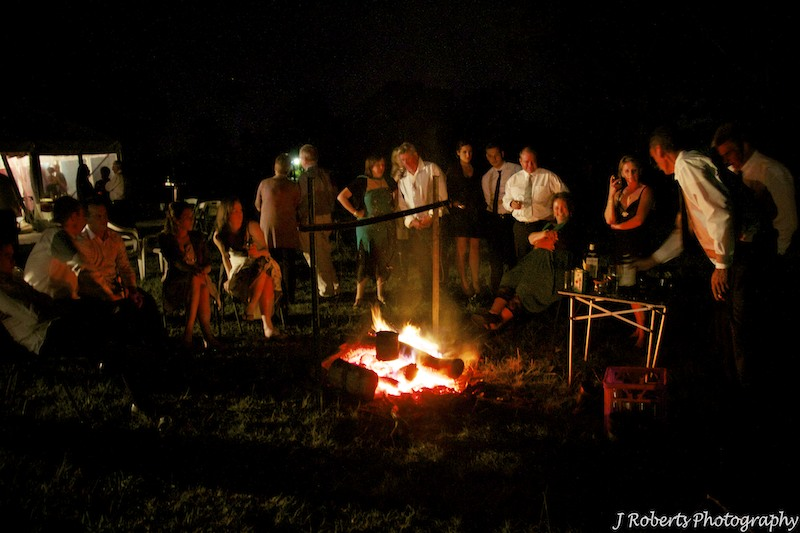 Guests around the fire - wedding photography sydney
