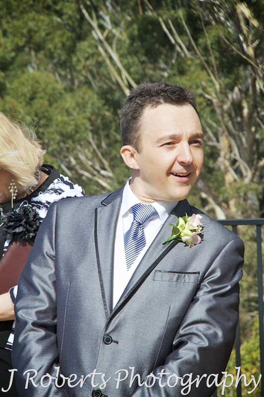 Grooms craning for a glimpse of the bride - wedding photography sydney