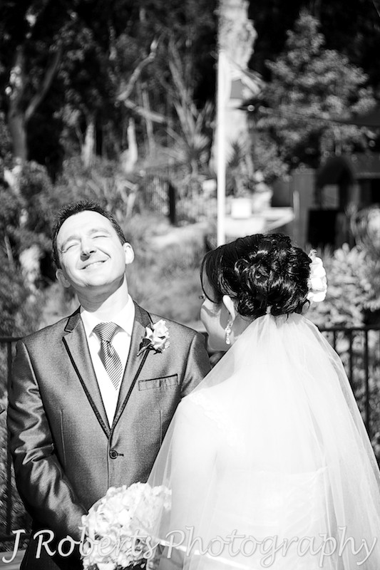 Groom laughing during the wedding ceremony - wedding photography sydney