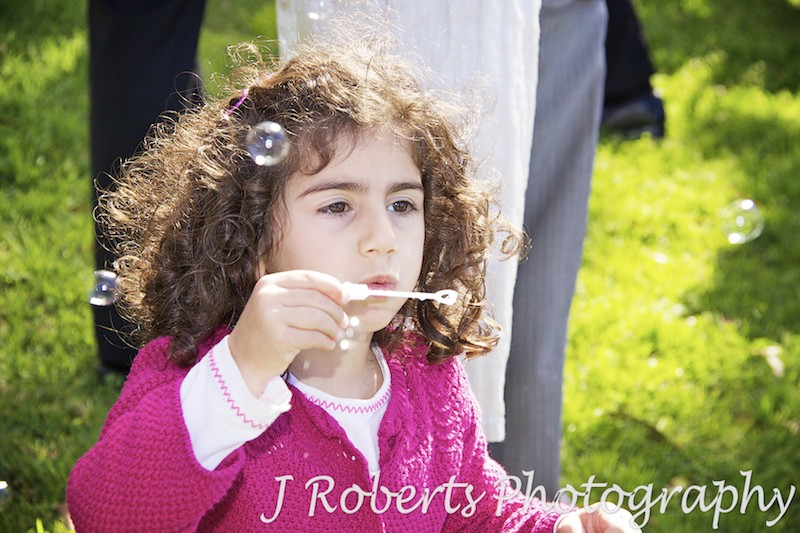 Little girl blowing bubbles - wedding photography sydney