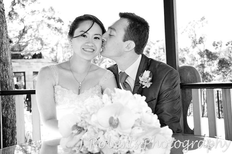 Groom kissing bride - wedding photography sydney