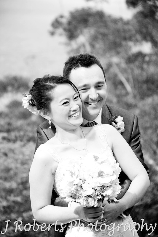B&W bride and groom smiling - wedding photography sydney