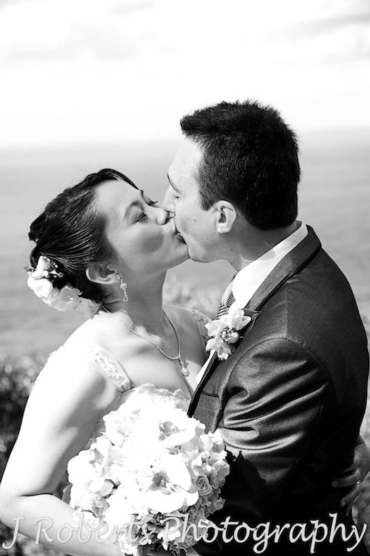 Bride and groom kissing in black and white - wedding photography sydney