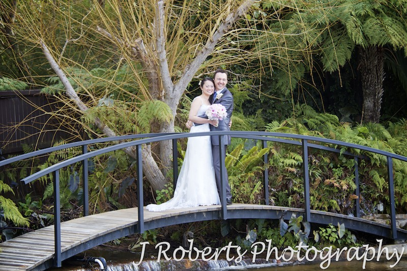 Bride and groom over a bridge - wedding photography sydney