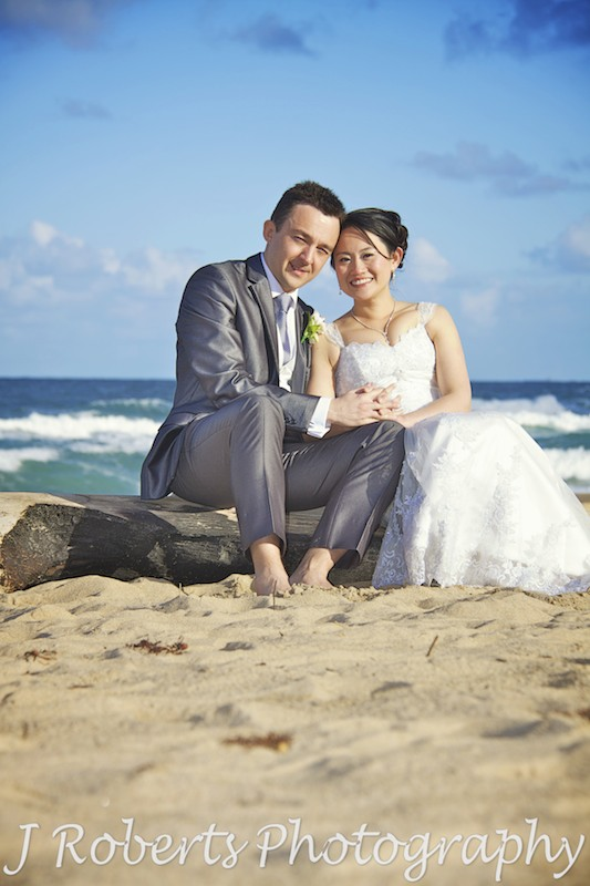 Smiling at the beach - wedding photography sydney