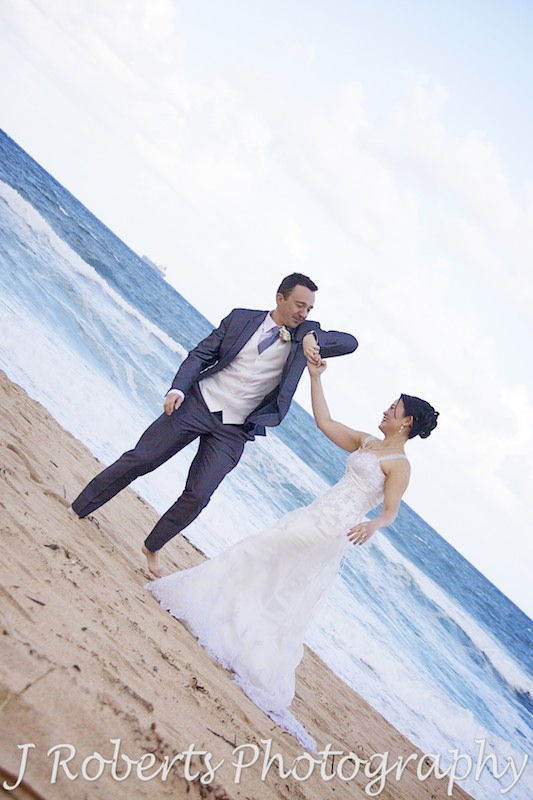 Bridal couple dancing on the beach - wedding photography sydney