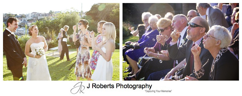 Blowing bubbles in celebration of marriage - wedding photography sydney