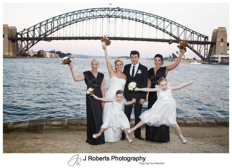 Jumping flower girls with bridal party on Blues Point -wedding photography sydney