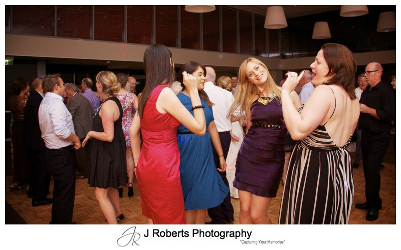 Fun dance floor action at wedding reception - wedding photography sydney