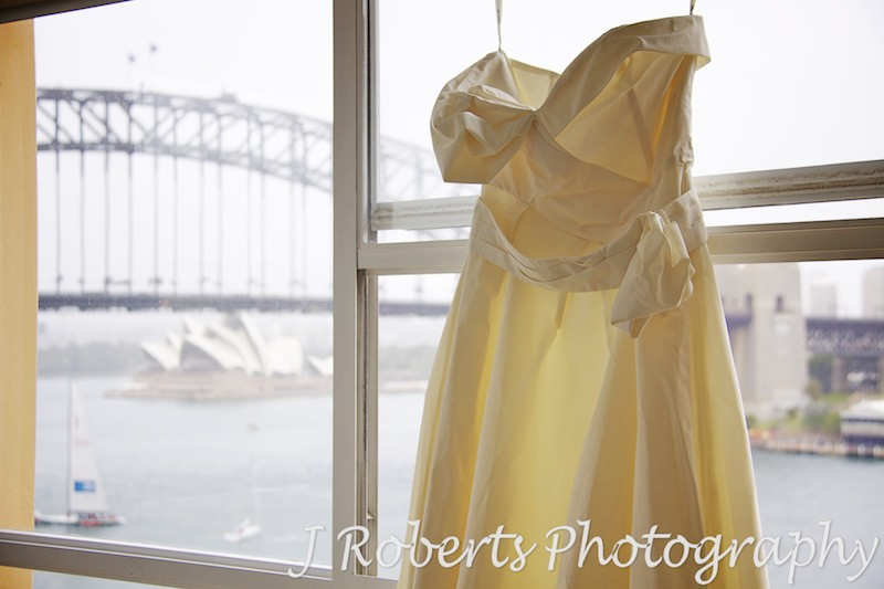 Wedding dress hanging up ready to put on - wedding photography sydney