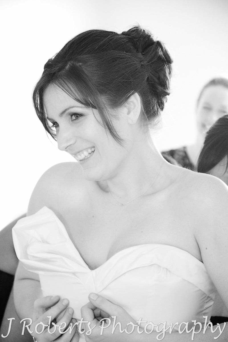 Bride having her dress zipped up - wedding photography sydney