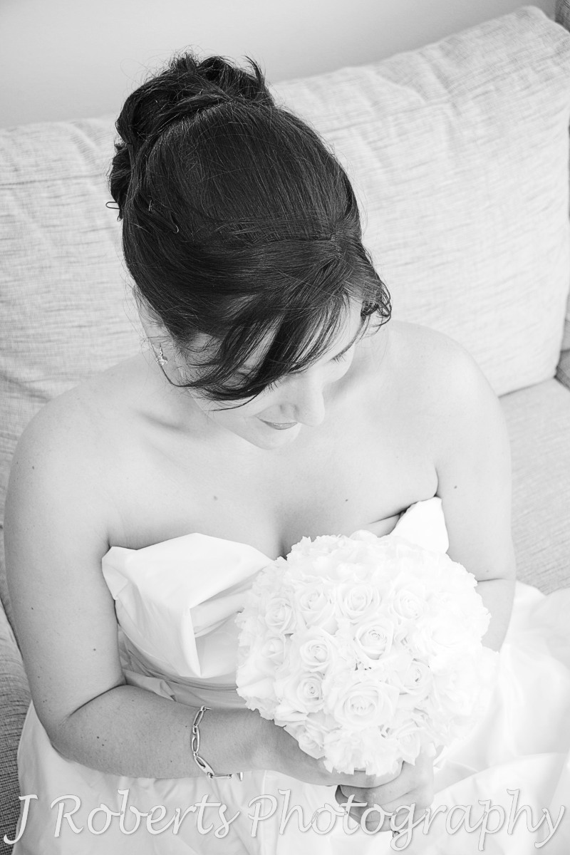 Bride looking down at her bouquet - wedding photography sydney