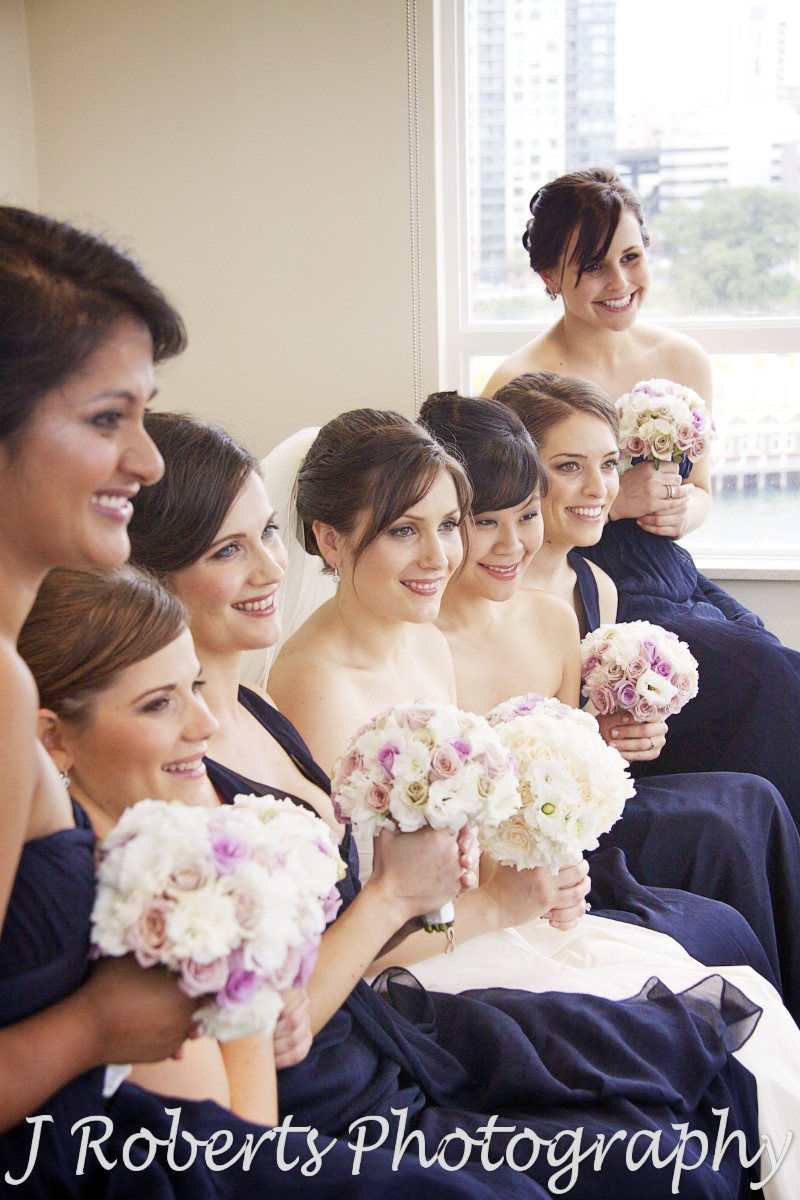 Bride smiling with bridesmaids - wedding photography sydney
