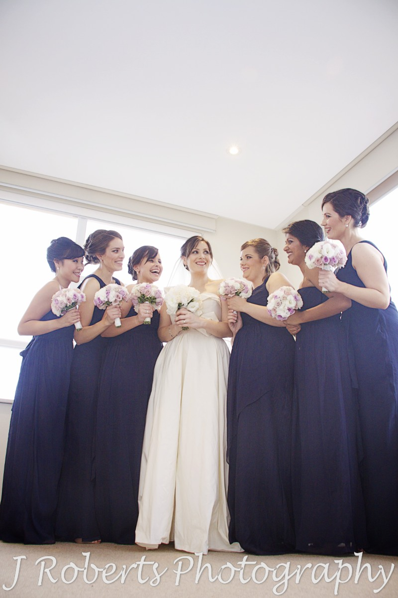 Bride laughing with bridesmaids - wedding photography sydney
