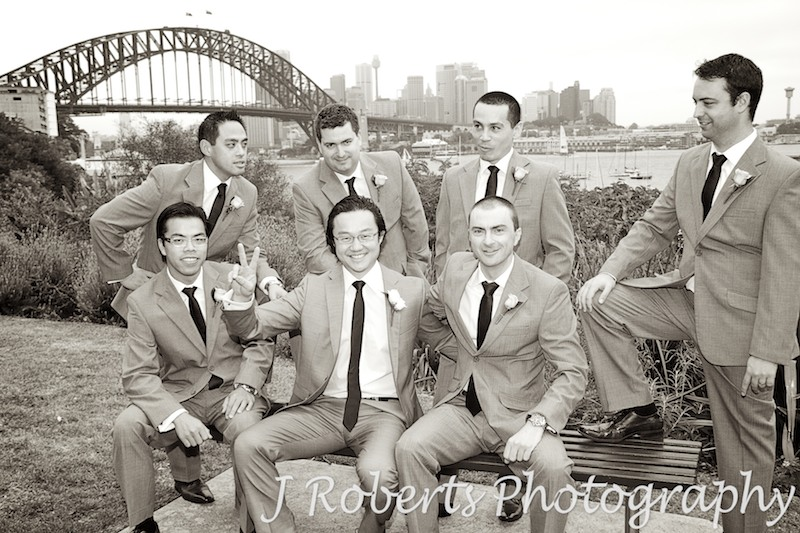Groom and groomsmen at Lavender Bay Reserve in Sepia - wedding photography sydney