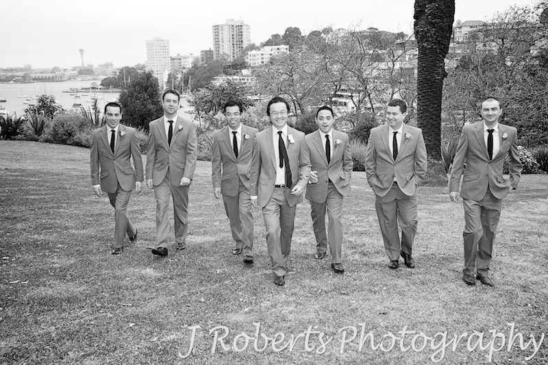 Groom walking in a line with groomsmen - wedding photography sydney