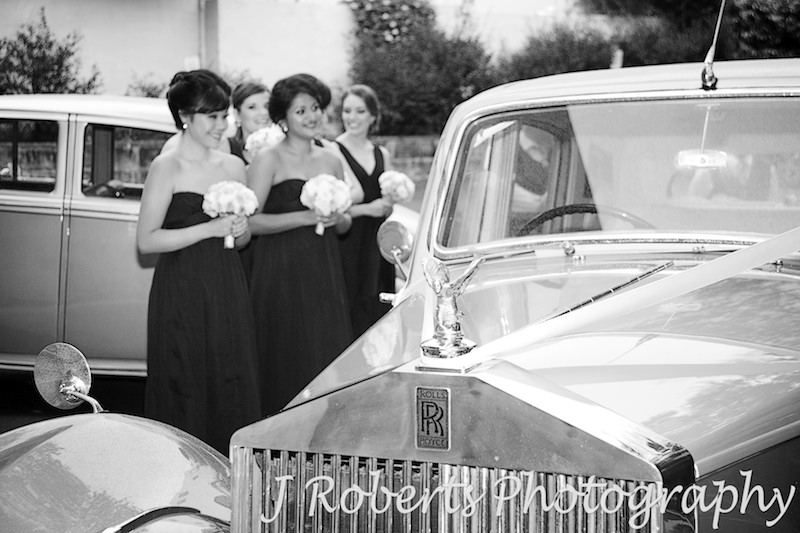 Rolls Royce bridal car with bridesmaids in the background - wedding photography sydney