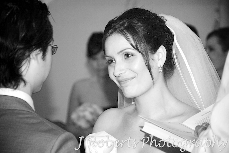 Bride smiling at groom during wedding ceremony - wedding photography sydney