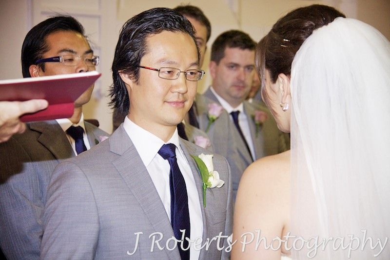 Groom smiling at bride during ceremony - wedding photography sydney