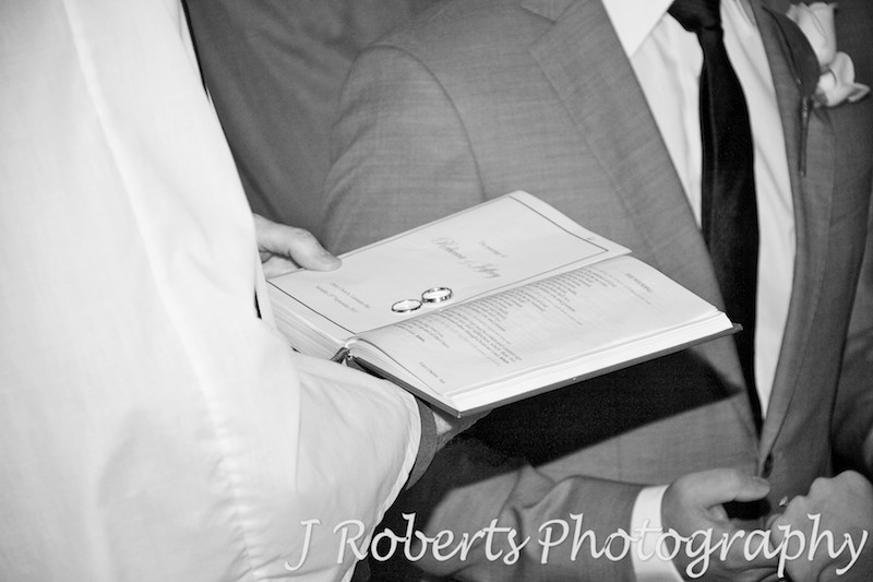 Wedding bands being blessed on the bible - wedding photography sydney