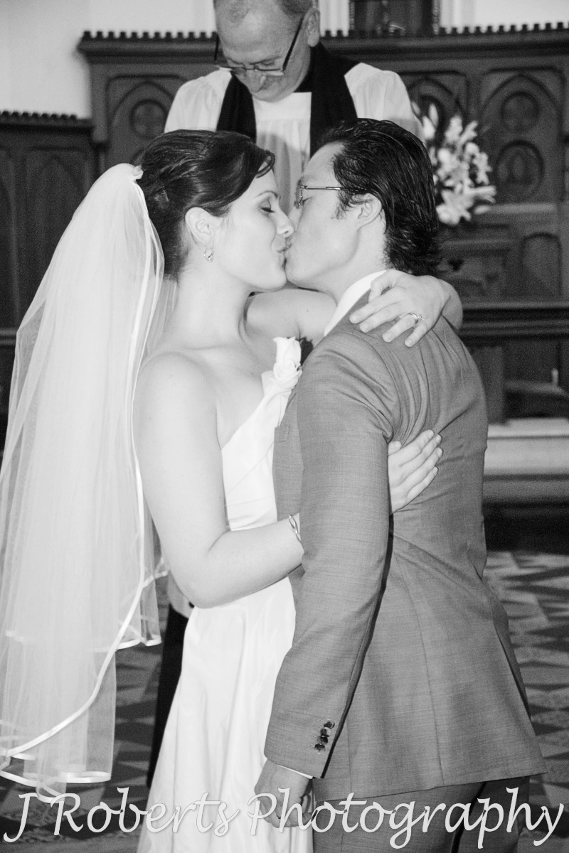 Bride and groom first Kiss - wedding photography sydney