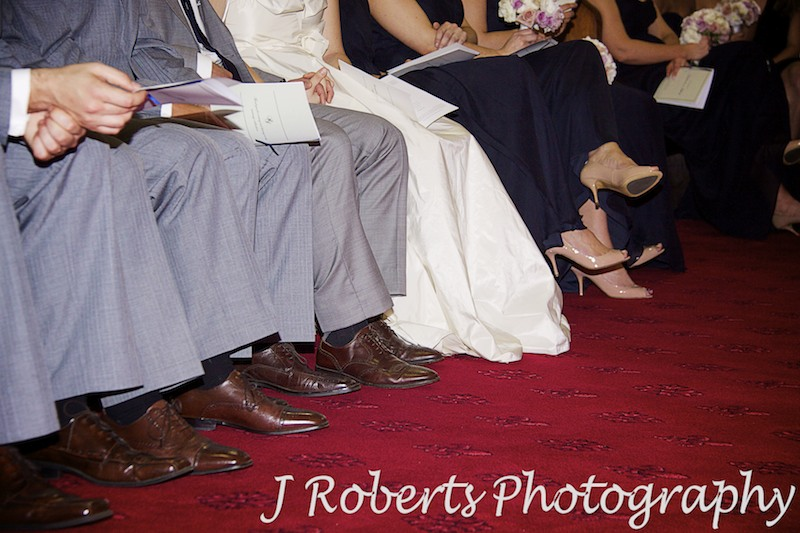 Bridal party sitting in front row of church - wedding photography sydney
