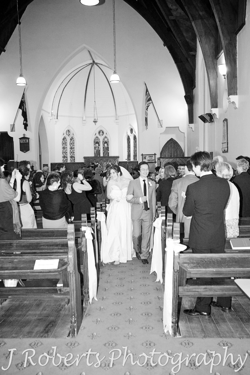Bride and groom walking down the aisle at Christ Church Lavender Bay - wedding photography sydney
