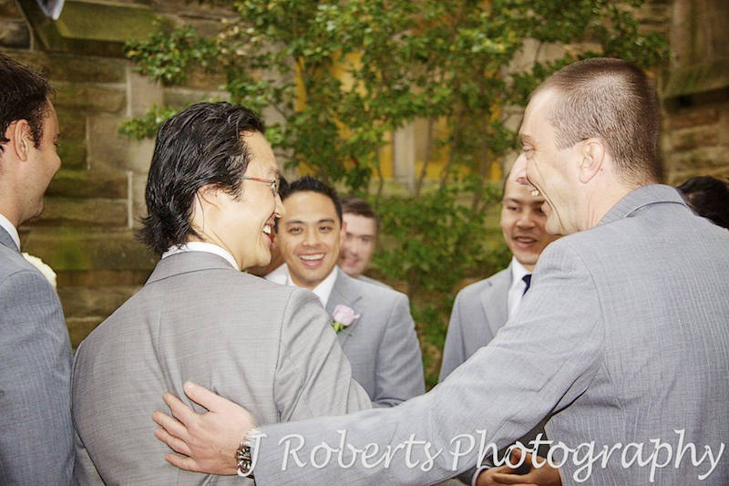 Groom being congratulated after wedding ceremony - wedding photography sydney