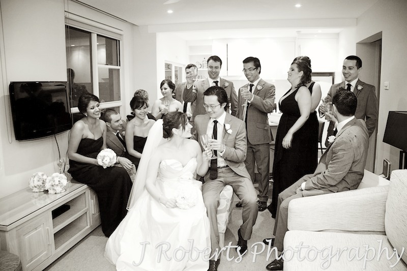 Bridal party cheersing with champagne - wedding photography sydney