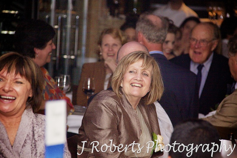 mother of the bride laughing at speeches - wedding photography sydney