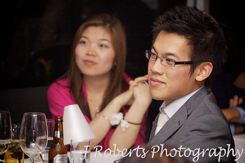 Guest listening to speeches at wedding reception - wedding photography sydney