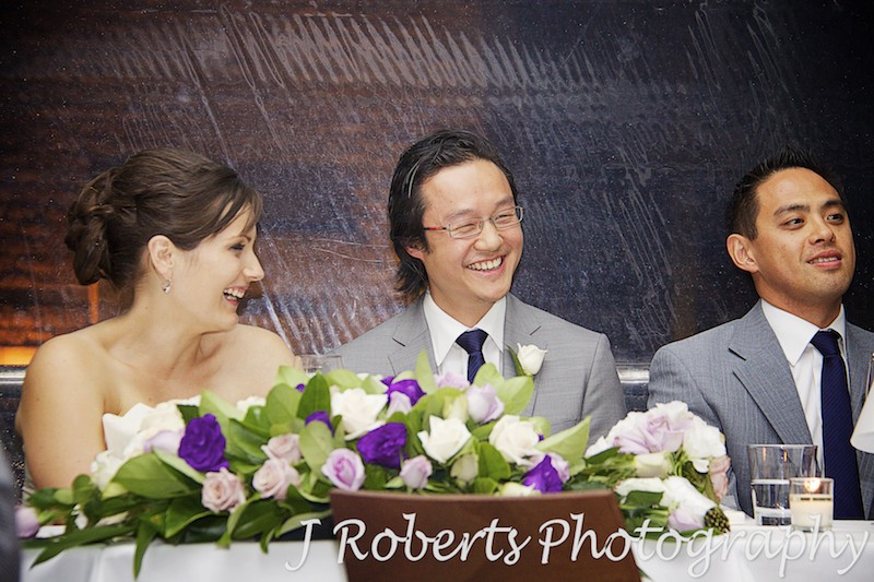 Groom laughing at speeches - wedding photography sydney