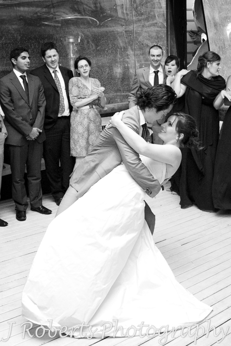 Groom dipping bride during bridal waltz - wedding photography sydney