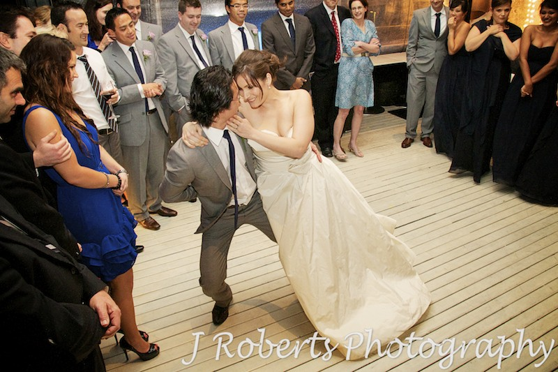 Bride leaning into groom while dancing - wedding photography sydney