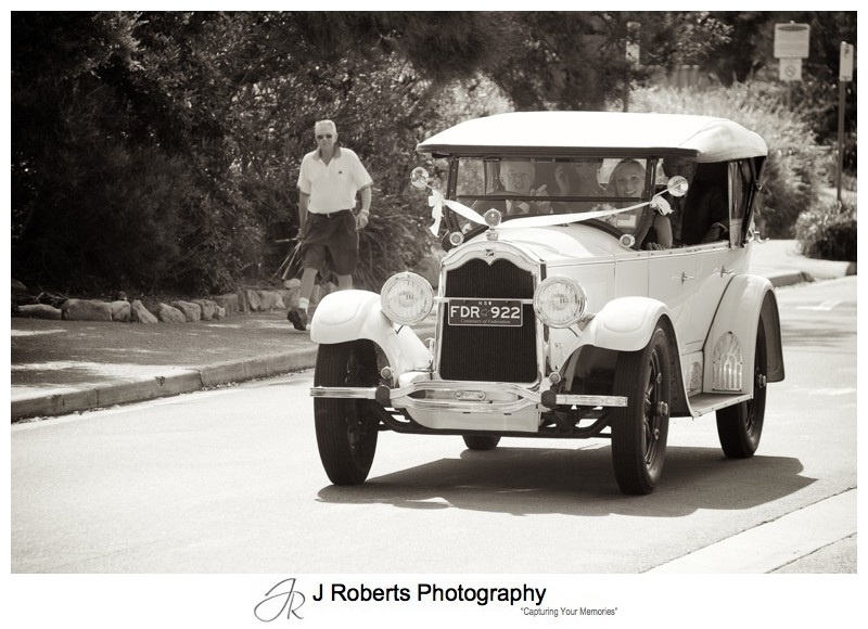 Bride arriving in a 1930 buick - wedding photography sydney