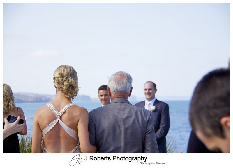 Bride walking down the aisle to the groom - wedding photography sydney