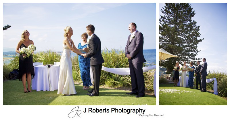 Bridal party laughing with Long Reef Beach in the background - wedding photography sydney