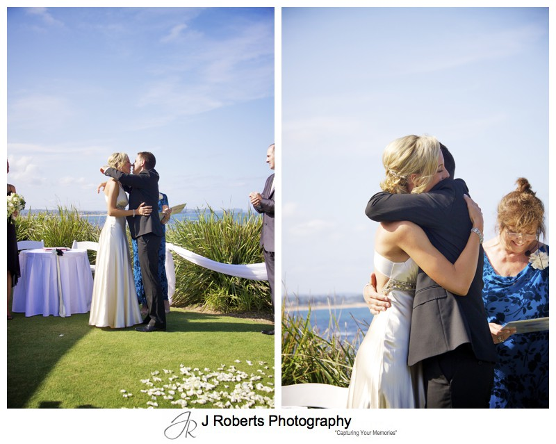 Couples first kiss and embrace as a married couple - wedding photography sydney